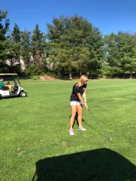 Tammy Lofink of Rising Above Addiction participates in the Sickle Drive Annual Invitational Golf Tournament