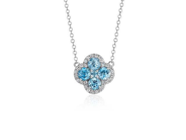 http://www.anrdoezrs.net/click-7016453-11436171-1443825873000?url=http%3A%2F%2Fwww.bluenile.com%2Fblue-topaz-halo-necklace-sterling-silver_50820