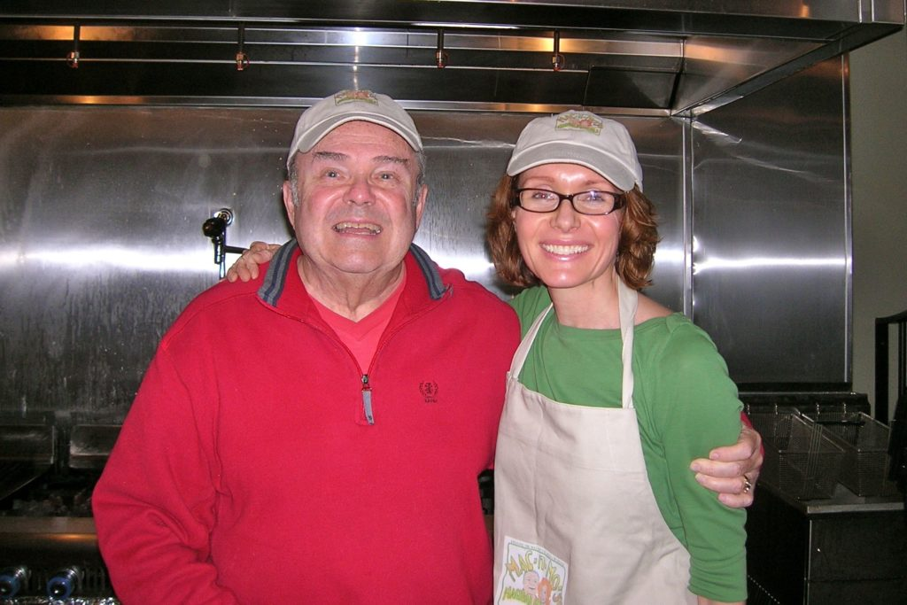 Mo and her dad Mac posing side by side in the kitchen.