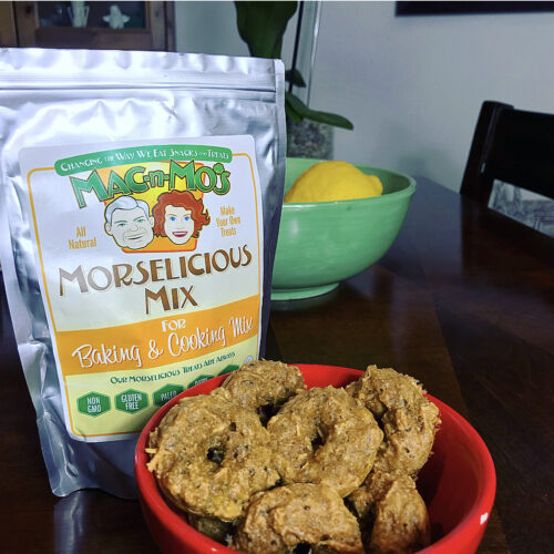 A red bowl full of mini donut treats in front of a bag of Mac-n-Mo's Morselicious Keto and Paleo-friendly Mix for Baking and Cooking.