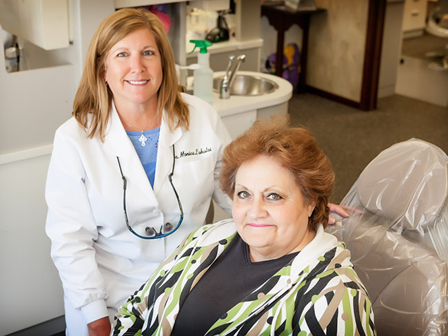 Dentist and Seated Patient