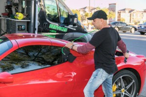 Locksmith using tools to get keys out of a locked Ferrari