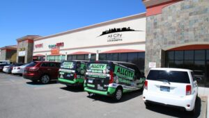 The front of All City Locksmith with Locksmith Vans parked in front