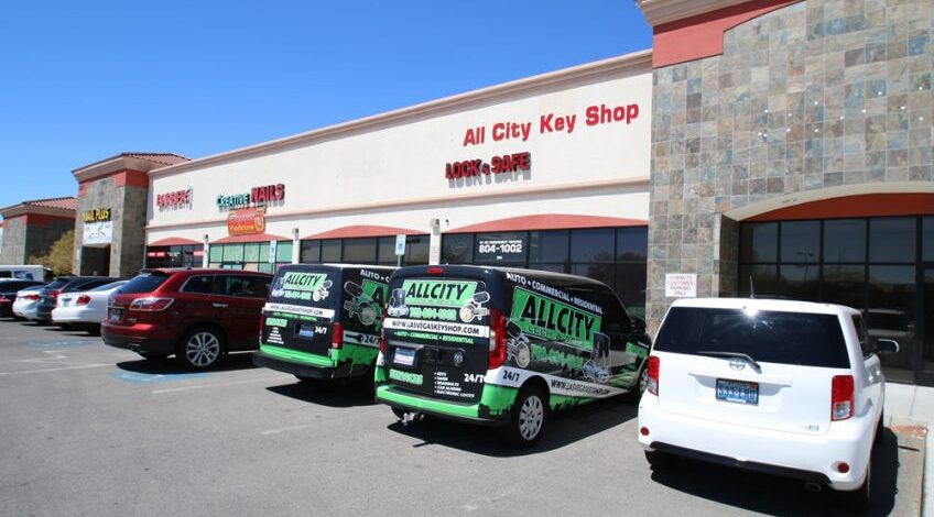 All City Locksmith Storefront with two all city branded vans