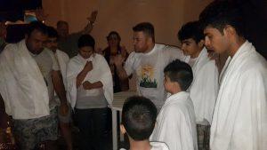 Kurdish Church--Osama preaching to those being baptized copy