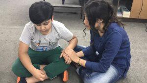 Kurdish Church young girl praying for young boy copy