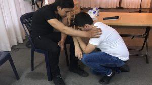 Kurdish church--man praying for another man copy