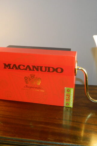 Made to be hung on a wall, this bright orange Macanudo ciagr box light features an arm on each side to make sure your Home office decor is both good looking and well lit. It has a false back that allows youo space to store your secret papers.