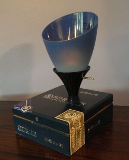A Blue PDR Cigar Box Lamp with an uplight blue shade and a soft glow. A great gift for Jazz Lovers.
