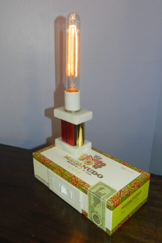 Macanudo Cigar Box Lamp is topped by a red trophy and lots of light. An unusal gift for him.