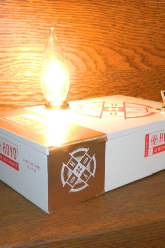 This Hoyo Cigar Box Lamp is white with red and gold accents. The perfect unique gift for dad.