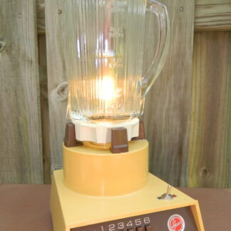 This Hoover Harvest Blender Lamp is a whimsical visit back to the 70's and makes a great Housewarming Gift for any Mid-century Modern Lover. With a flaming light inside and clean lines and bold Gold color on the outside