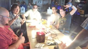 Build & Brew participants react with joy when the switch is filled and their cigar box lamps are illuminated.