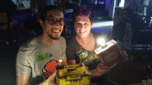 A mother and son display the cigar box lamps they built at a Build & Brew event.