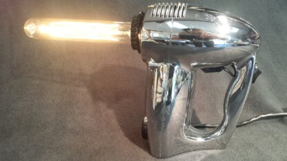 This Ray Gun Lamp was created from a hand mixer and we think you'll agree, it's stunning! The chrome like finish and elegant design make this one-of-a-kind lamp unforgettable.