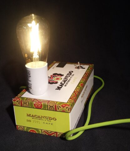 This Neon Macanudo has a rugged neon green power cord and a wide base, it is nearly impervious to being knocked over. With bright colors and a bold design, this cigar box lamp is sure to be a hit!