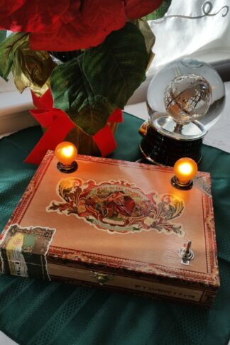 The Golden Glow is a Unique Gift for Women. Crafted from an elegant Flor de Las Antillas wooden cigar box, it's detailed dipiction of women and warm wood tones are a match for any decor.