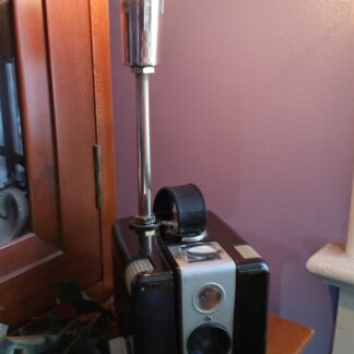 Crafted from a vintage Kodak Bulls-eye II Brownie style camera, with a light replicating an oldfashioned flashbulb. This Vintage Camera Lamp is sure to be a perfect gift for any photographer.