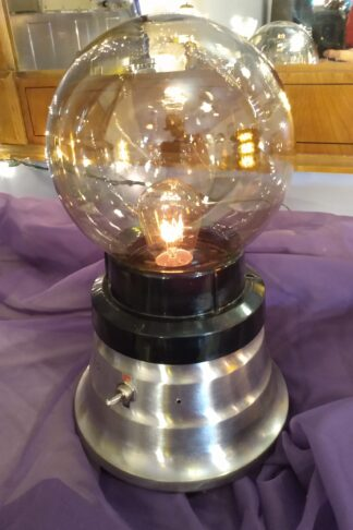 This Fortune Teller Lamp sports a brushed stainless steel base and a tinted globe, as well as a low profile, making it a great lamp for any room in the house and a great gift for your best friend.