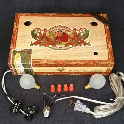A Flor del las Antilles Cigar Box Lamp Kit with all the parts needed to create a lamp.