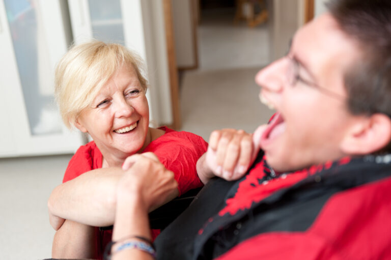 Disability Support Worker looking up at a Man.