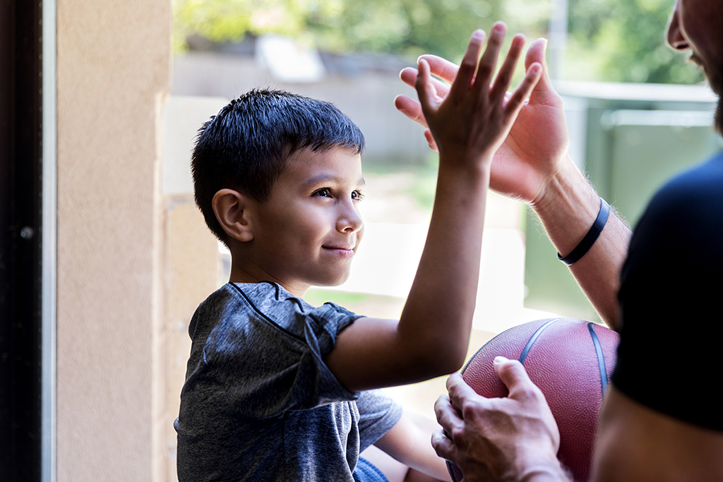 A young boy gives a high-five