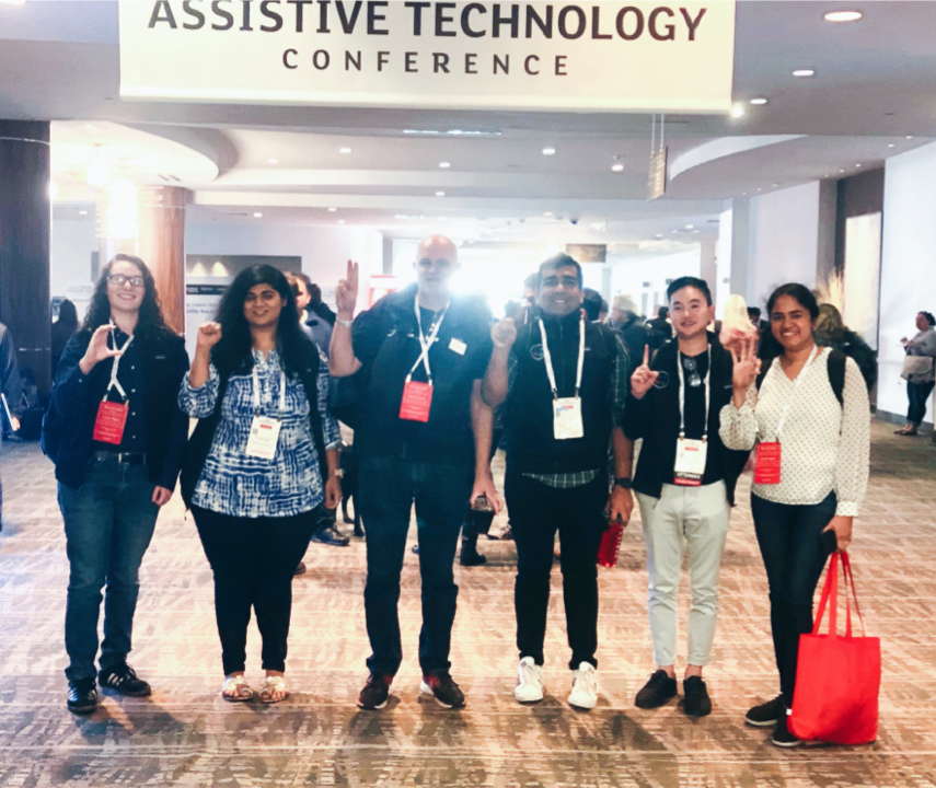 Team picture of Intuit Accessibility team under CSUN conference sign