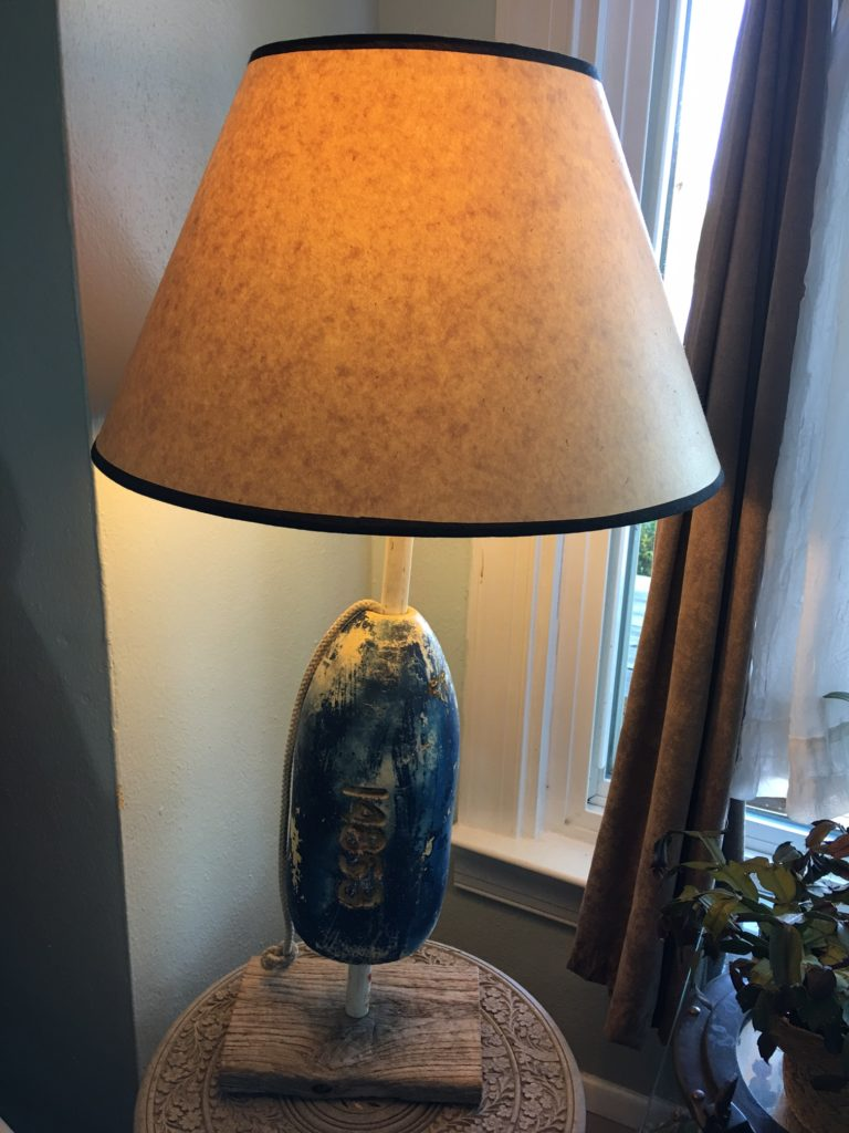 Recycled crab float, line, lampshade. Lamp parts.