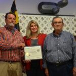 MDA Deputy Secretary Julie Oberg presents a citation to Donnie Bowen (left) and father Leslie (Page) Bowen