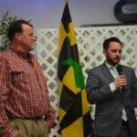 Scott Travers of Senator Van Hollen's office presents Donnie with a citation