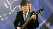 Angus Young playing guitar for AC/DC