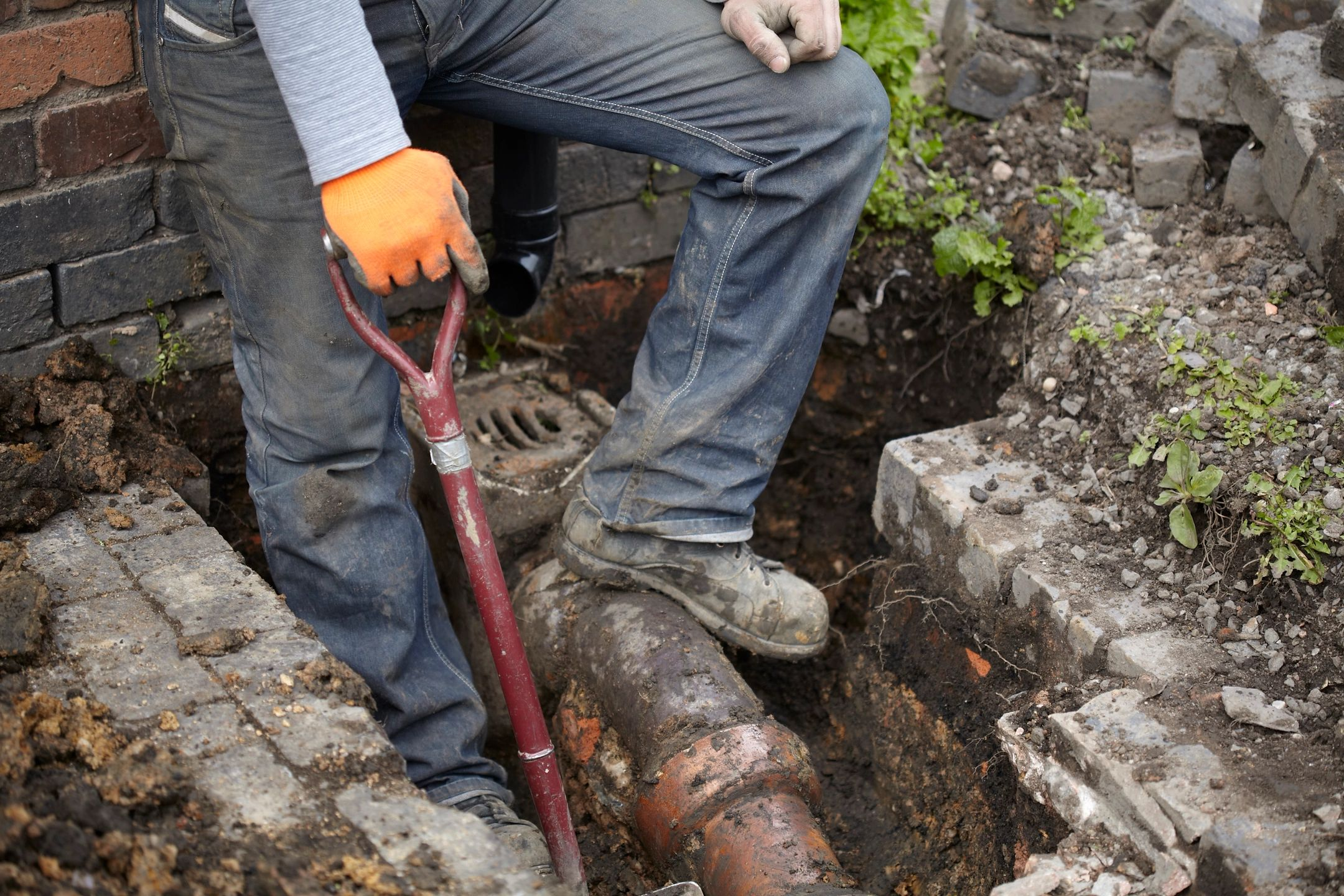 Worker conducting drain removal services in Joliet, IL