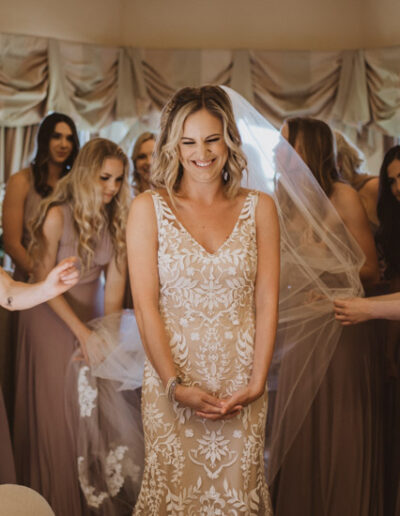 Bridesmaids seeing the bride in her wedding dress for the first time by McKenzie Shea