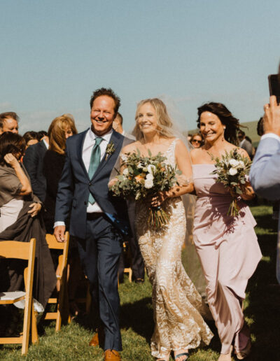 Bride's parents walking her down the aisle by McKenzie Shea