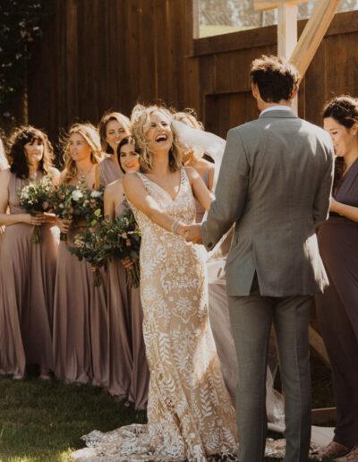 Happy bride on her wedding day by McKenzie Shea