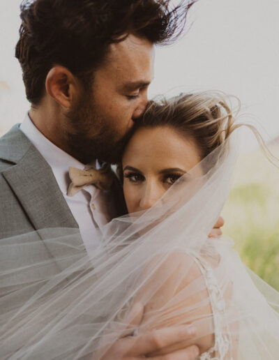 Romantic Veil Shot of a Bride and Groom by McKenzie Shea
