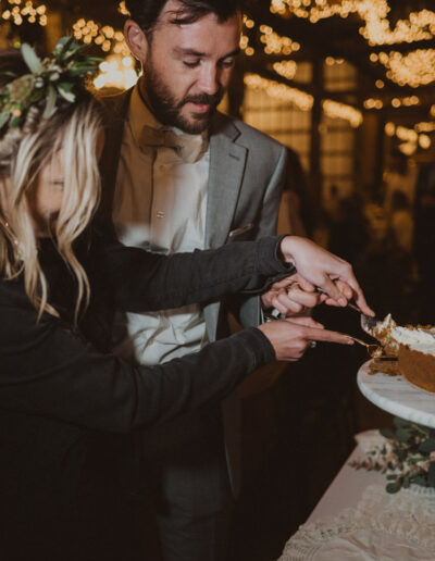 Bride and Groom cutting the cake by McKenzie Shea Photography