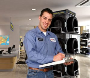 Tire Dealer with Clipboard