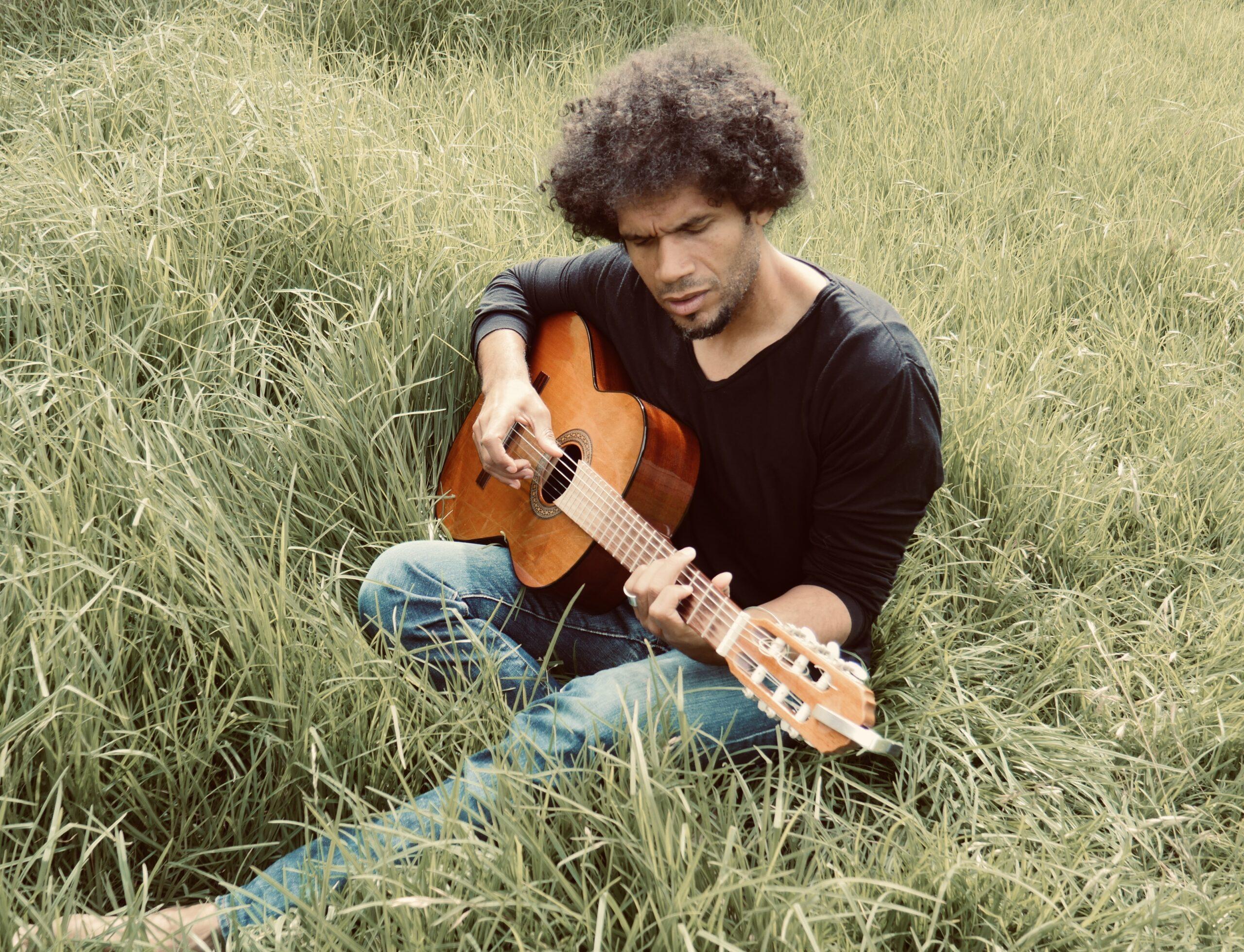 Damen Samuel - playing his nylon string in nature