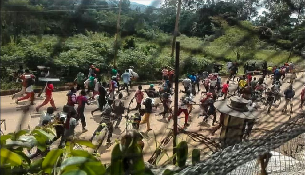 PHOTO: This frame grab taken from video footage shows crowds fleeing with items after they stormed a United Nations compound on the outskirts of the eastern town of Beni, Democratic Republic of Congo, Nov. 25, 2019.