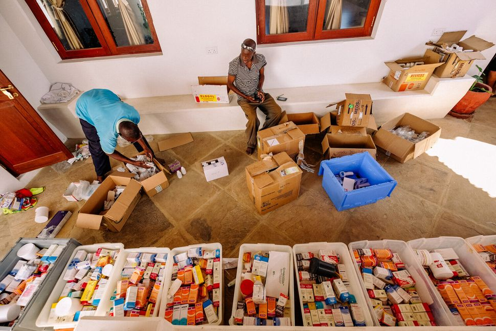 Each trip by Safari Doctors takes several days. Before launching their boat, they pack waterproof boxes with medicines and su