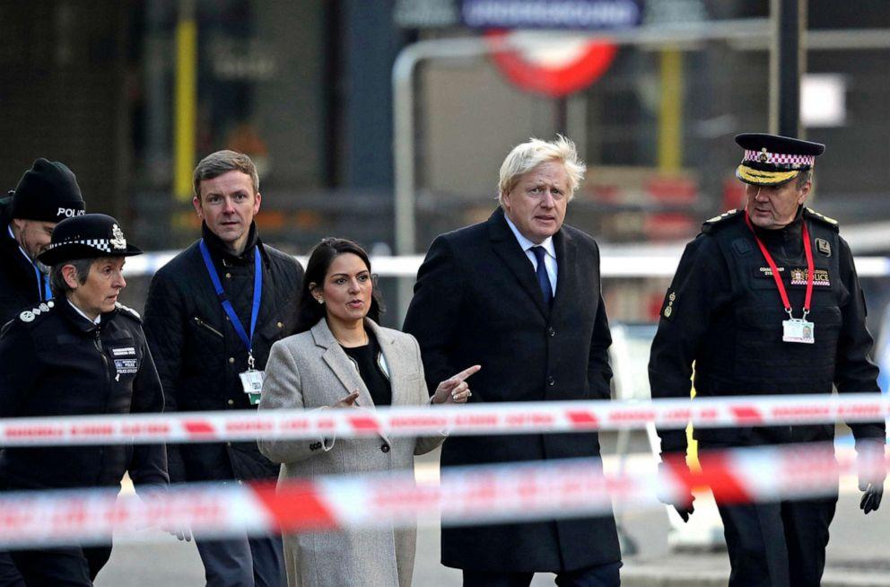 PHOTO: Britains Prime Minister Boris Johnson, second right, Home Secretary Priti Patel, center, and Metropolitan Police Commissioner, Cressida Dick, left, attend the scene in central London, Saturday, Nov. 30, 2019.