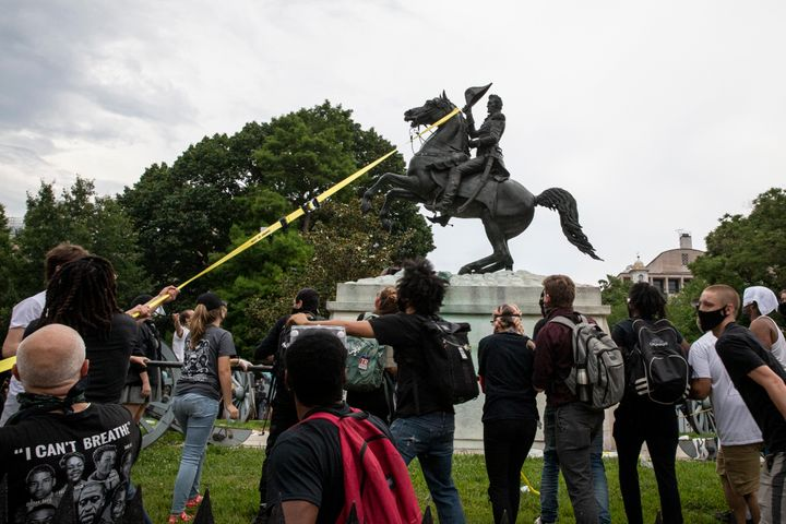 WASHINGTON, DC - JUNE 22: Protestors attempt to pull down the statue of Andrew Jackson in Lafayette Square near the White Hou