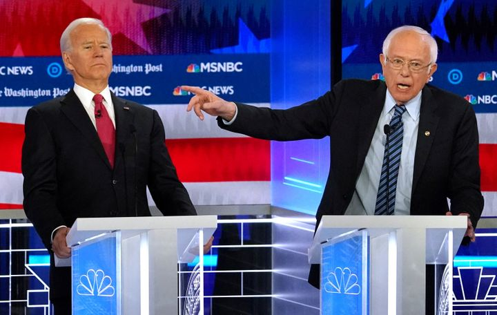 Sen. Bernie Sanders (I-Vt.), right, criticized Joe Biden for signing off on trade deals that cost the U.S. manufacturing jobs