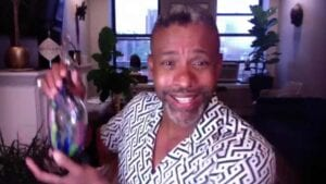 Musa Jackson mixing drinks on ZOOM