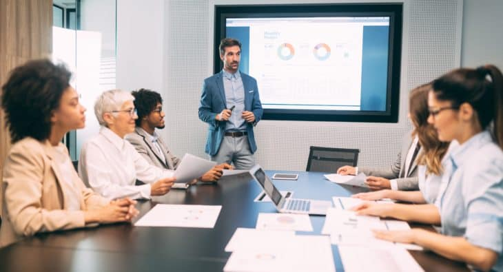 Business colleagues having meeting in conference room in office