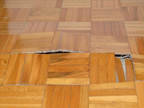 Buckled Parquet Floor