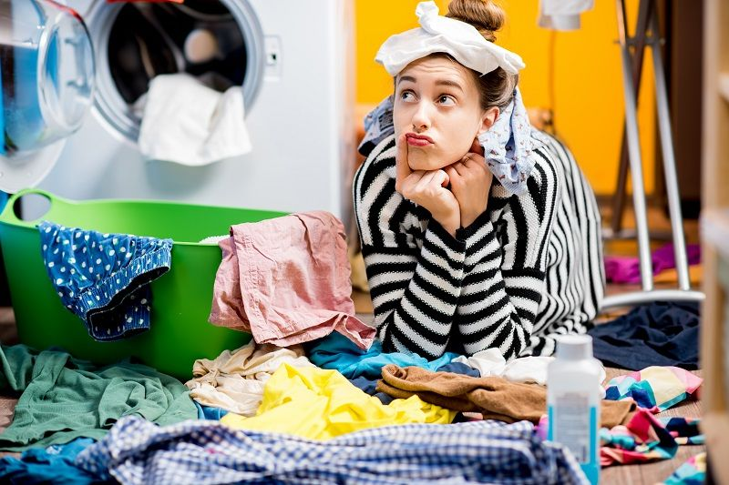 Woman-washing-clothes-at-home-cm