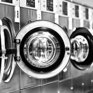 Washing machine row with open doors-cm