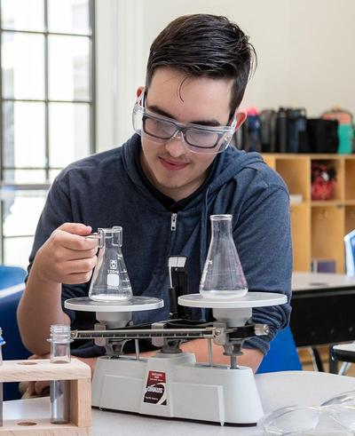 Science - Kid measuring flasks.1cf32b962564cae4b2a786caaab836d4